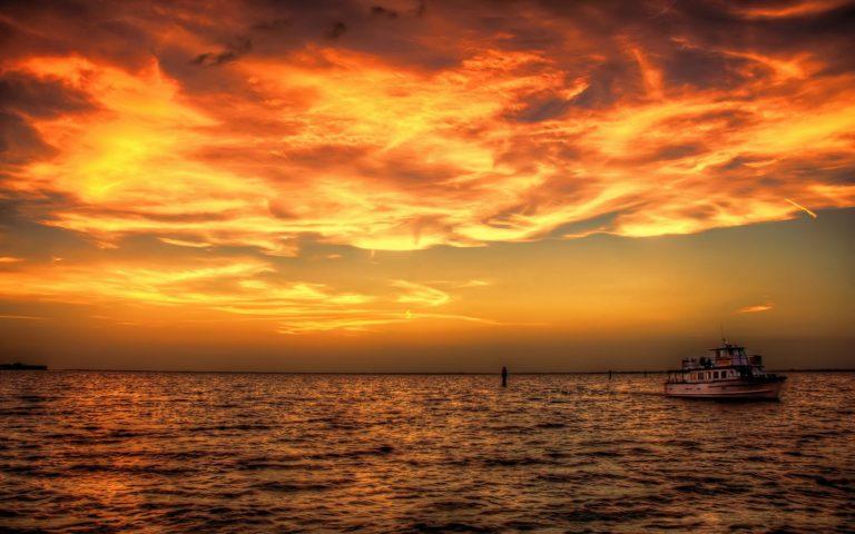Sunset Sea Ship Ocean Sky Clouds Boat 1920 x 1200 768x480