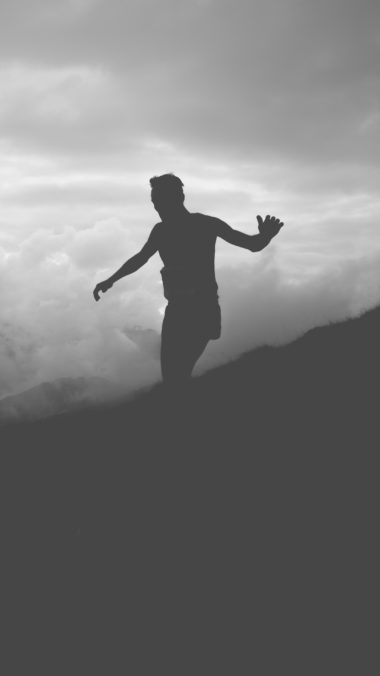 Man Silhouette Clouds Mountains Bw Wallpaper 2160x3840 380x676