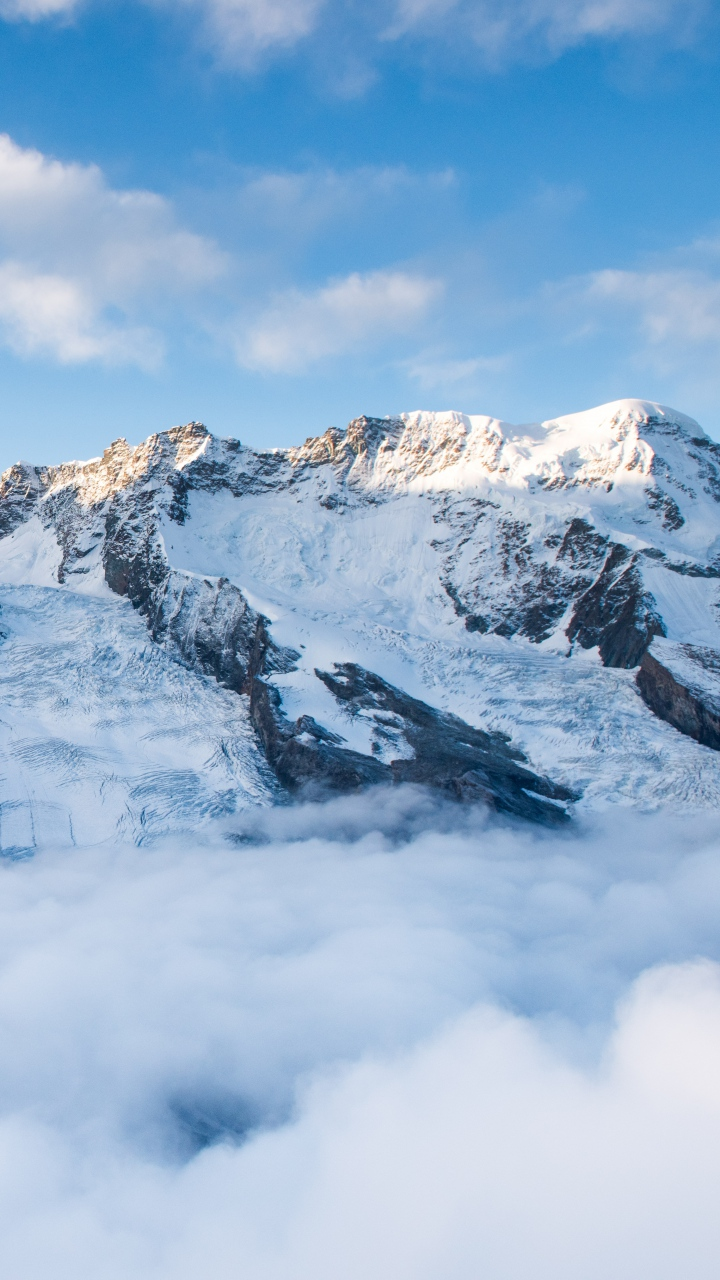 Mountains Summit Snow Clouds Wallpaper 720x1280