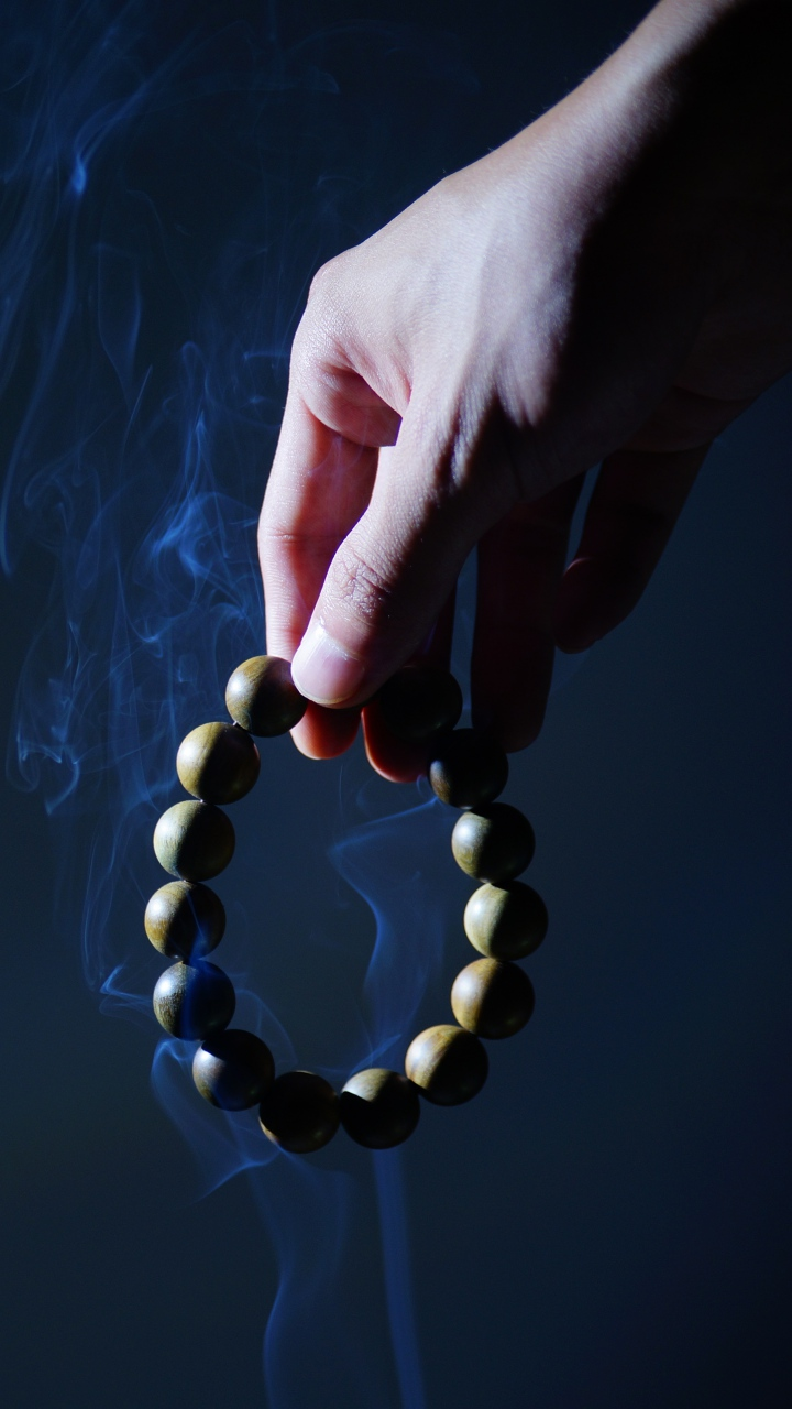 Rosary Hand Smoke Wallpaper 720x1280