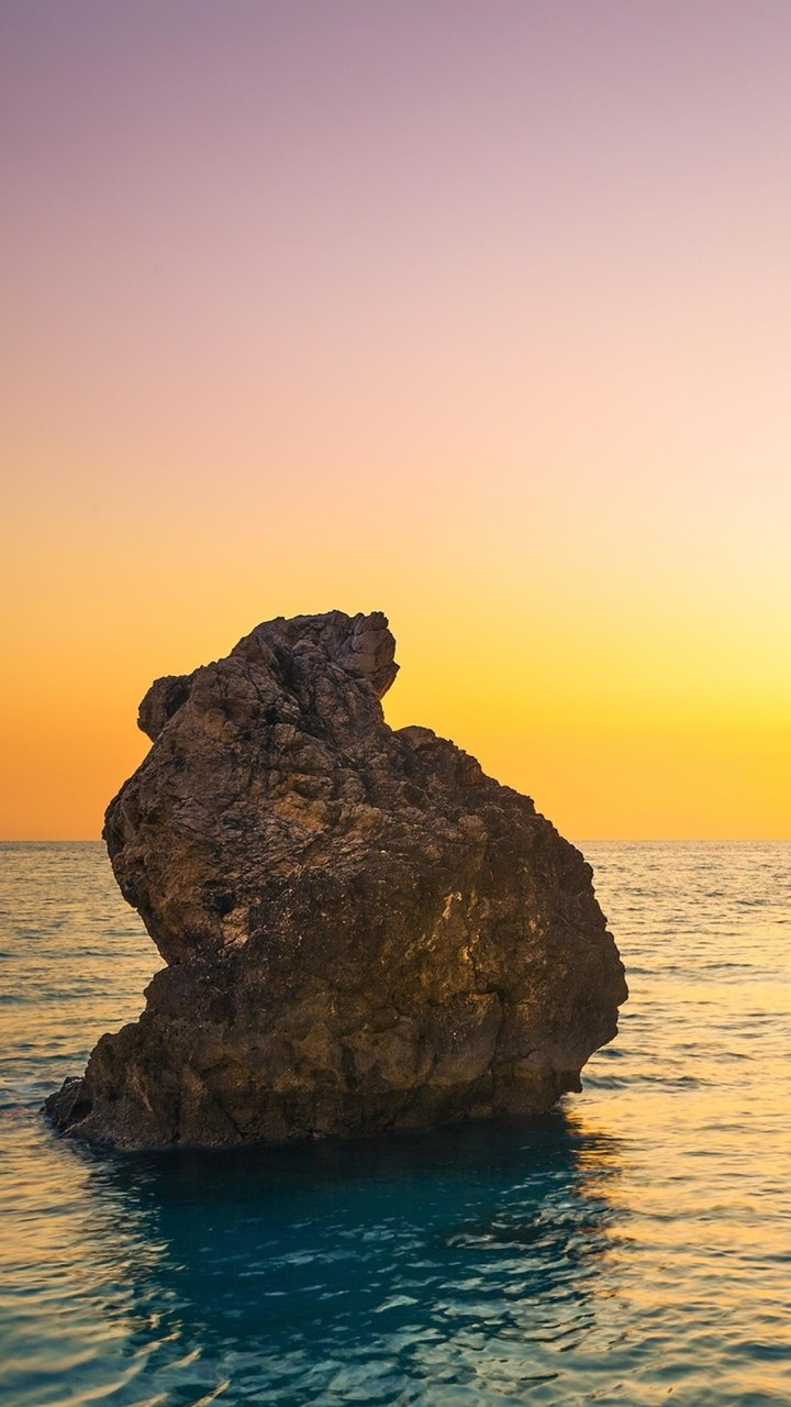 Sea Boulders Sky Sunrise Wallpaper 720x1280