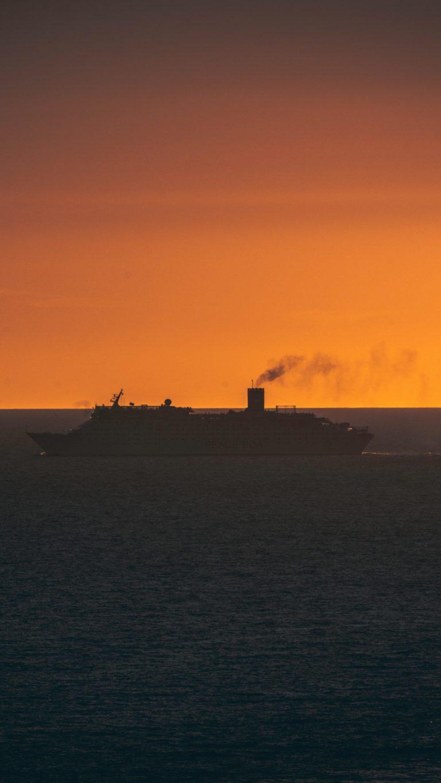 Ship Swimming Sunset Horizon Wallpaper 2160x3840 768x1365