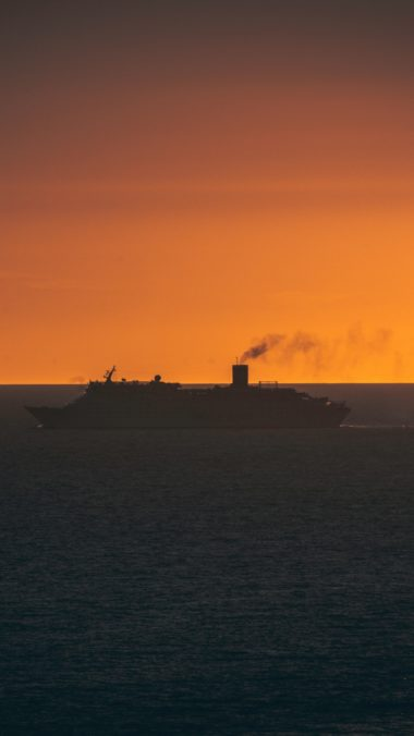 Ship Swimming Sunset Horizon Wallpaper 720x1280 380x676