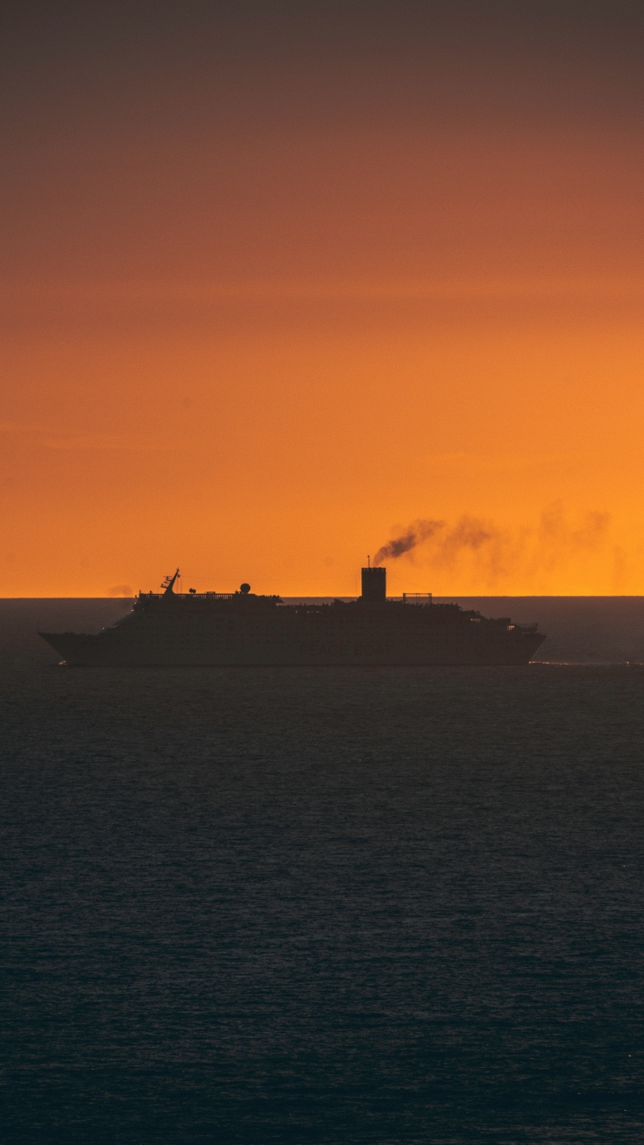 Ship Swimming Sunset Horizon Wallpaper 720x1280