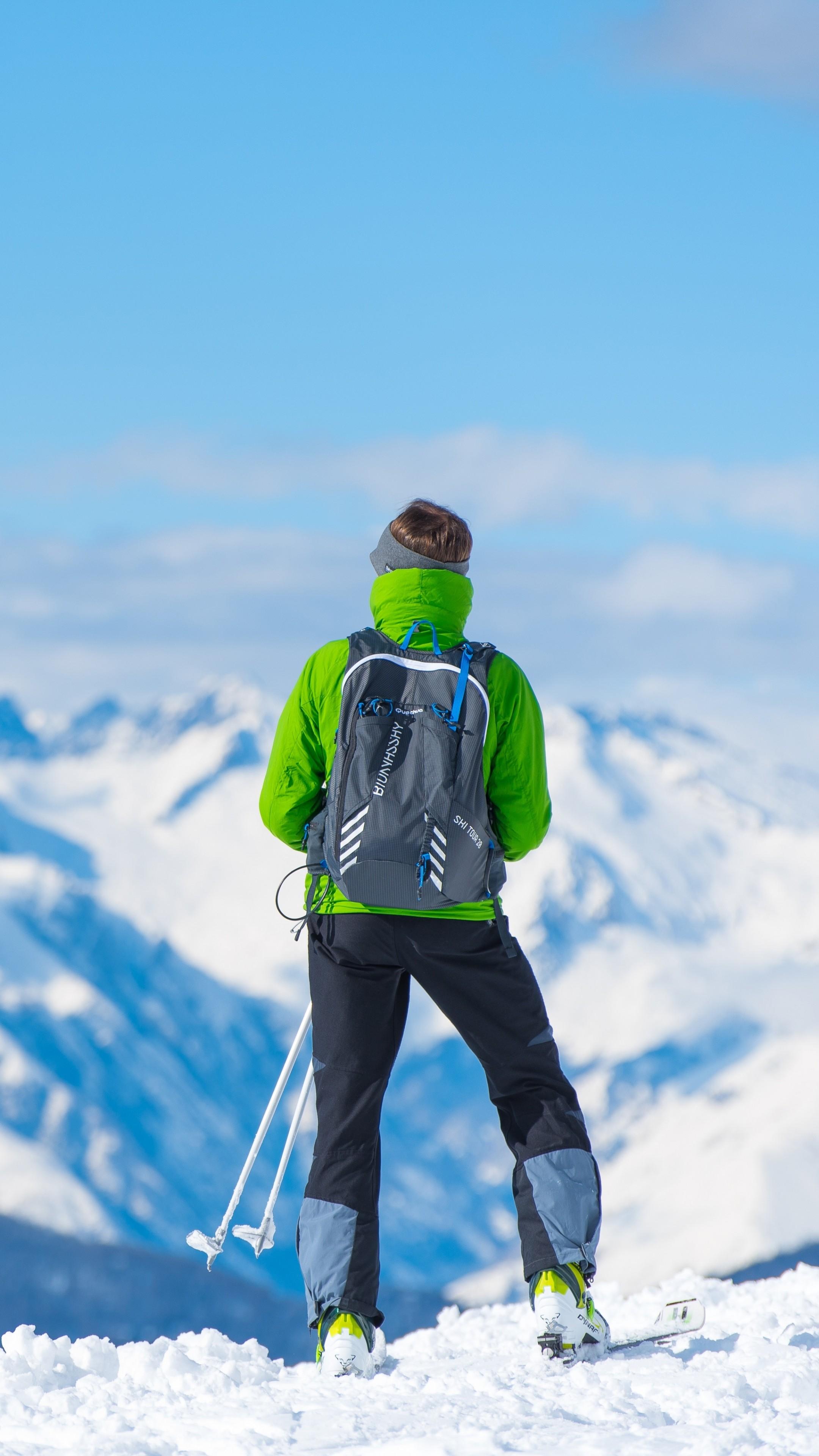 sportsman skiing mountain top tourist wallpaper - [2160x3840]