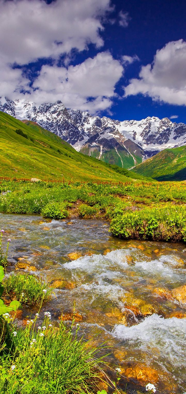 Scenery Mountains Stream Grass Clouds Wallpaper