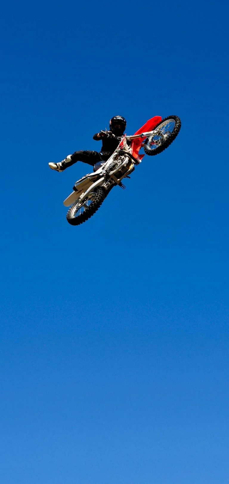 Bike Jump Blue Sky Wallpaper 1440x3040 768x1621