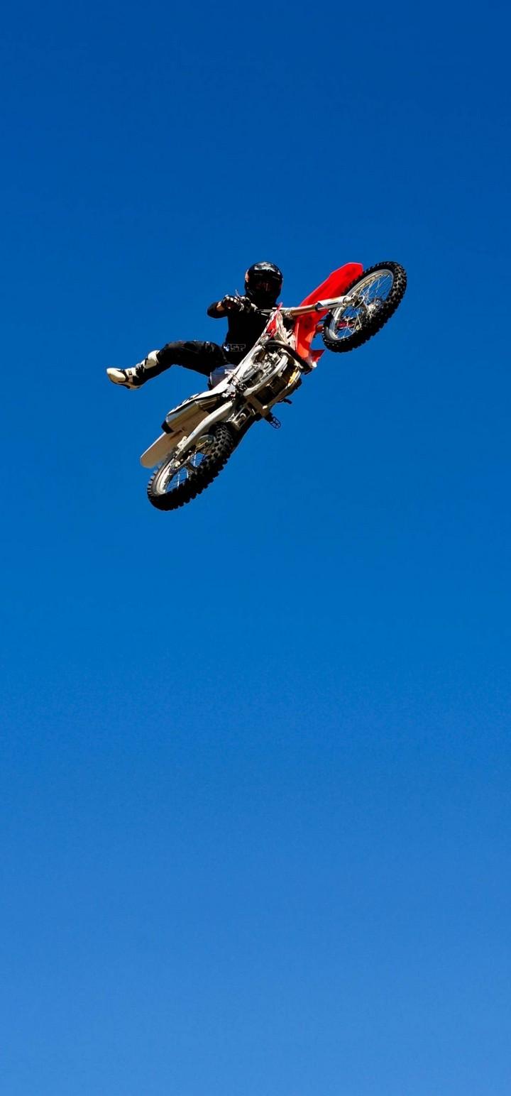 Bike Jump Blue Sky Wallpaper 720x1544
