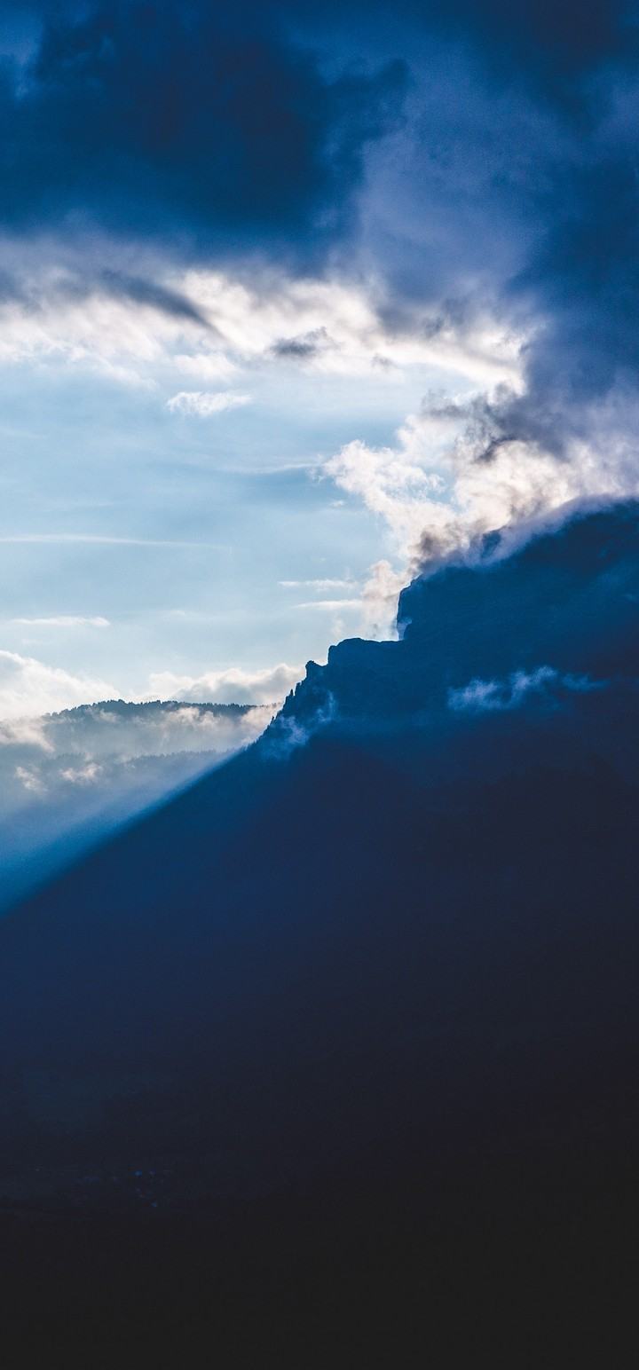 Mountains Clouds Rays Wallpaper 720x1544