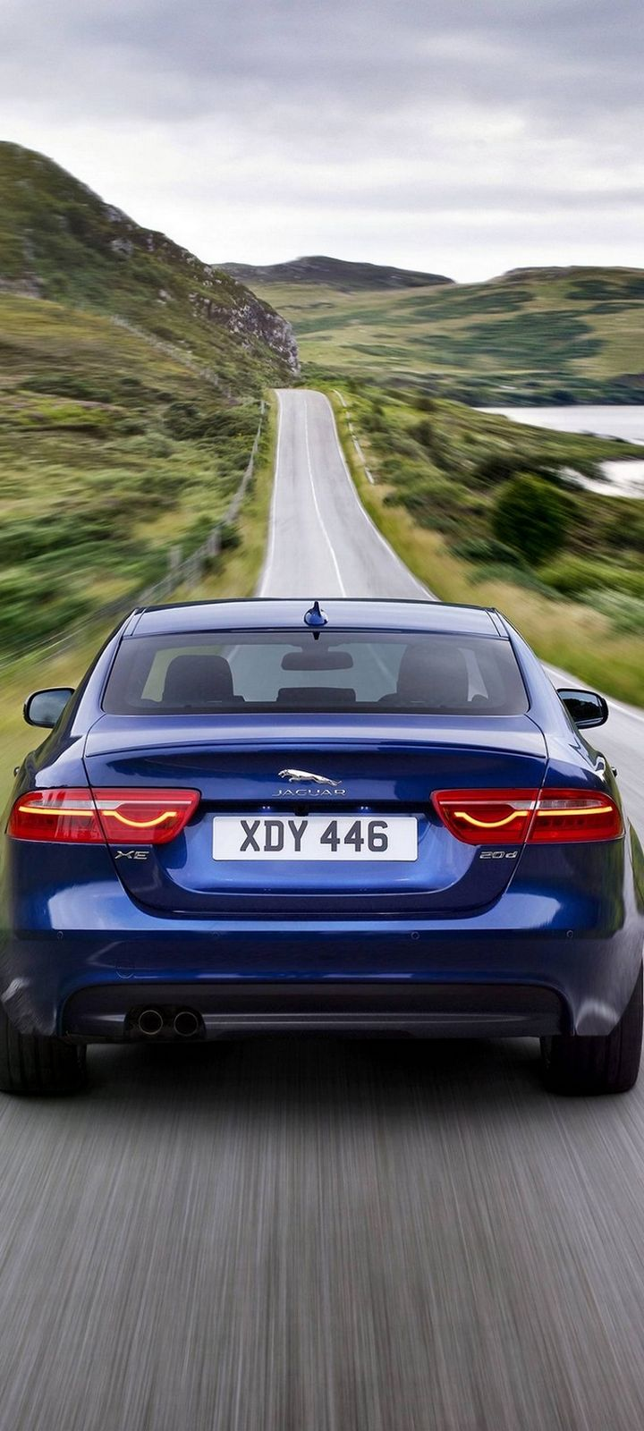 Jaguar XE Car Blur Wallpaper 720x1600