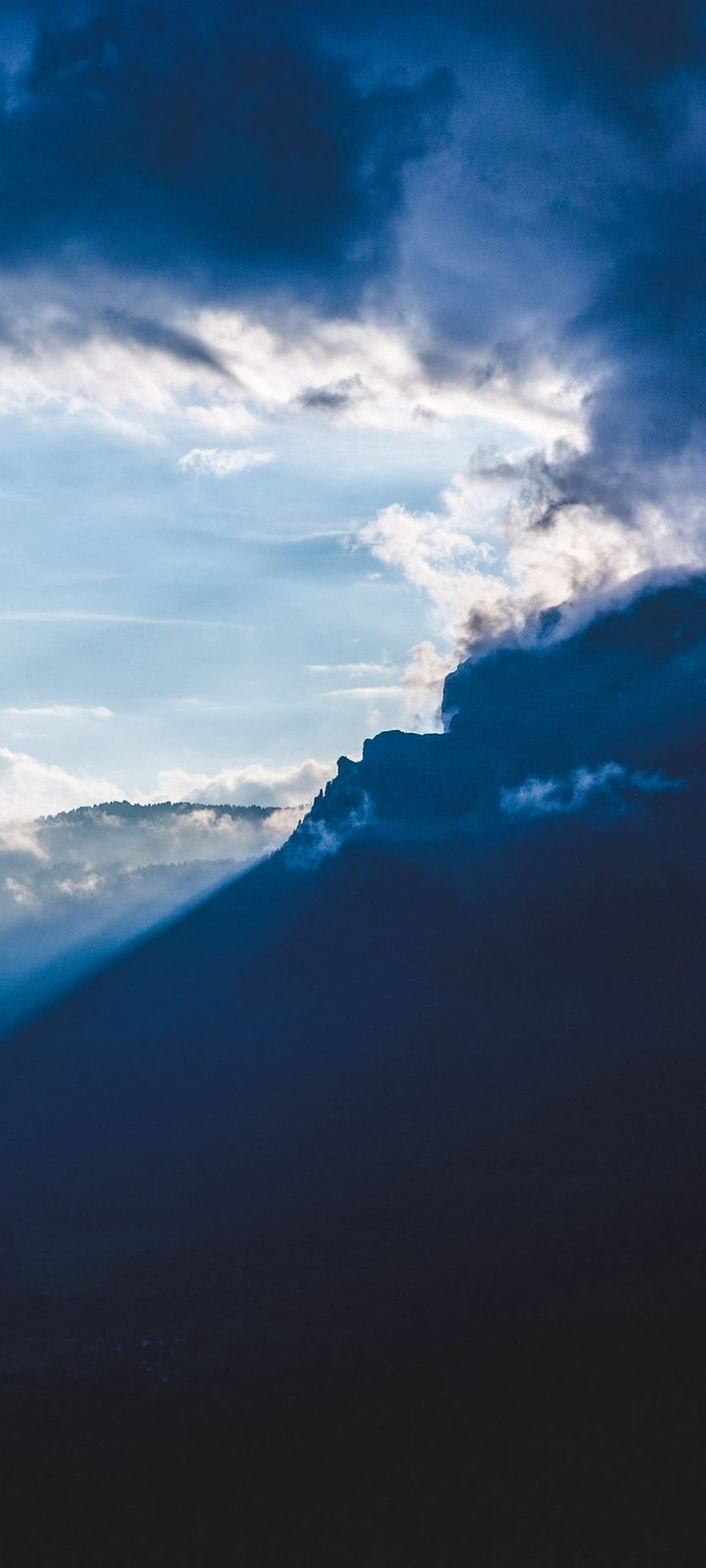 Mountains Clouds Rays Wallpaper 720x1600